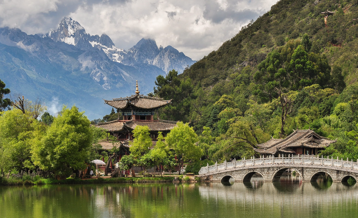 Black Dragon Pond with a Jade Dragon Snow Mountain in the background. Near Lijiang in Yunnan Province, China 2011. Photos